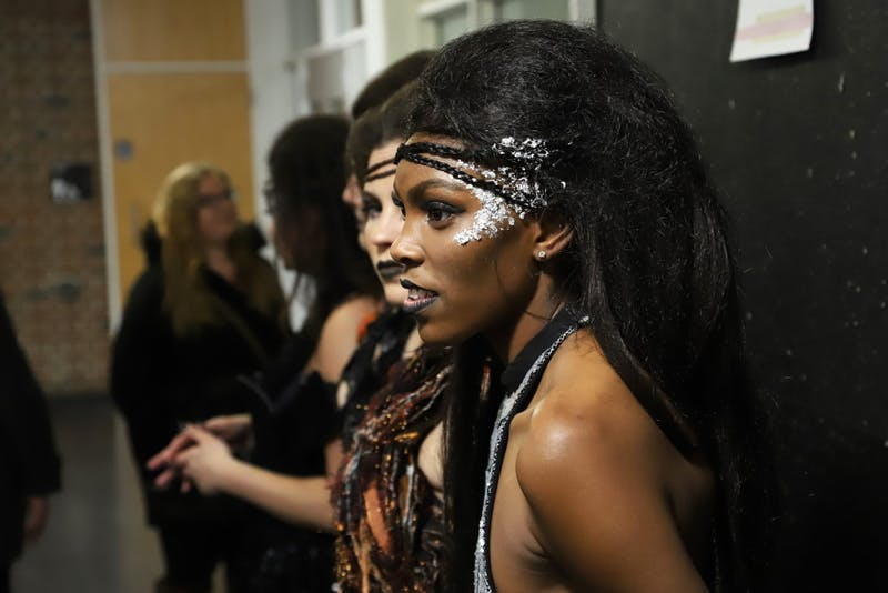 "Mariah Shingler waits back stage during ""e.motion,"" the University of Minnesota's apparel design fashion show on Saturday, Feb. 2 at Rapson Hall. Shingler modeled for Pyro fashion designed by Emily Dufault."