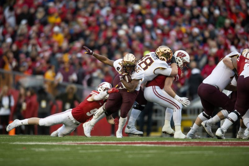 Runningback Mohamed Ibrahim breaks a tackle at Camp Randall Stadium in Madison on Saturday, Nov. 24. The Gophers beat the Badgers 37-15 for the first time since 2003. Ibrahim finished the game with 121 yards and a touchdown.
