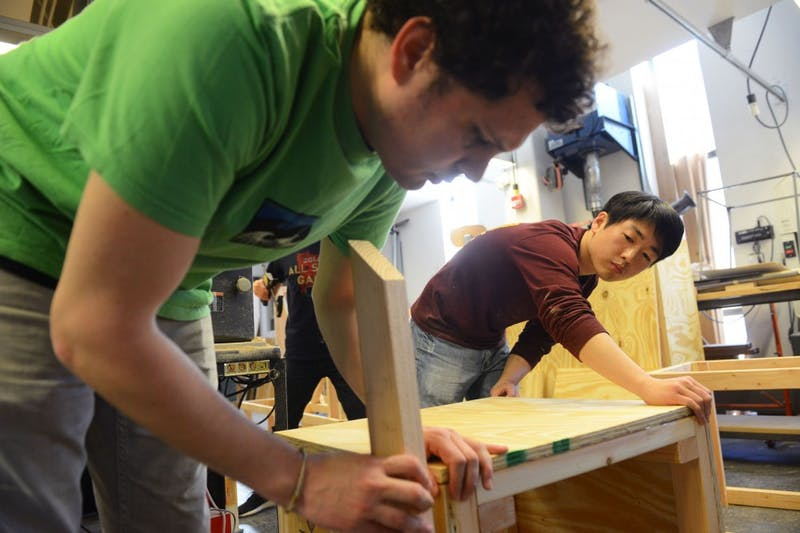 Graduate students Alberto Babio and Deuk-Geun Hong build WAM's upcoming pop-up park in the W.L. Hall Workshop inside Rapson Hall on Sunday. Created by the WAM Collective student group, the park will take over the museum's front plaza from April 20 to May 10.