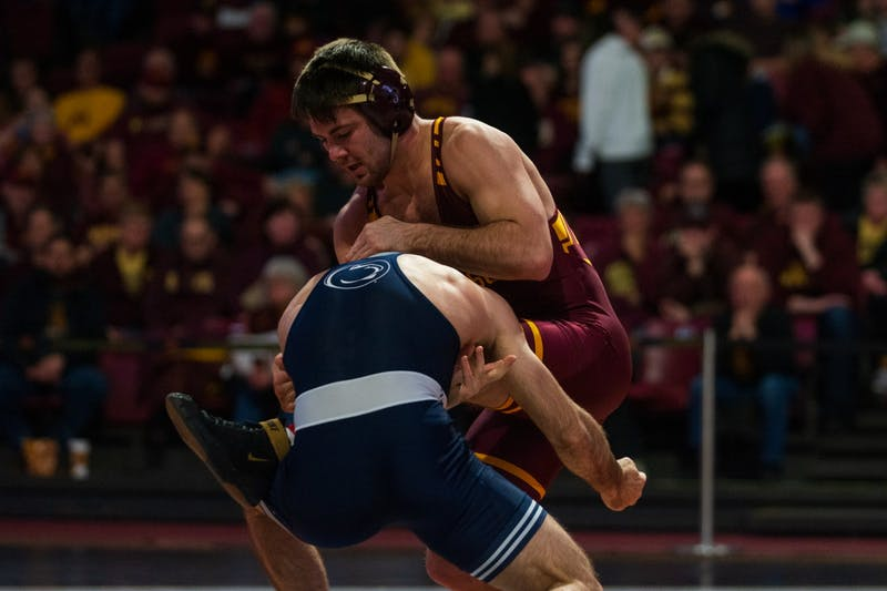 Gophers Redshirt Freshman Brayton Lee fights a takedown at Maturi Pavilion on Sunday, Feb. 9. The Gophers lost to Penn State 31-10.