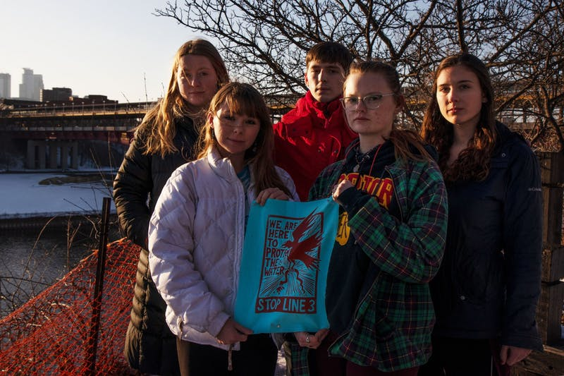 "From left, Grace Hogan, Madeline Miller, Benjamin Perez, Elizabeth Zanmiller and Sally Zuzuly, officers of the new ""Students Against Pilelines"" student group, pose for a group portrait by the Mississippi river on Friday, Feb. 21. Miller says that issues around pipeline construction, including Line 3, affect students on campus as well as the rest of the state."