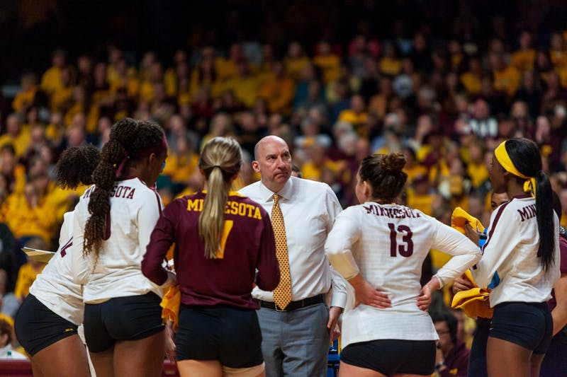 Head Coach Hugh McCutcheon speaks with his team at the Maturi Pavilion on Thursday, Nov. 14. The Gophers ended the night with a 3-1 loss against the Badgers.