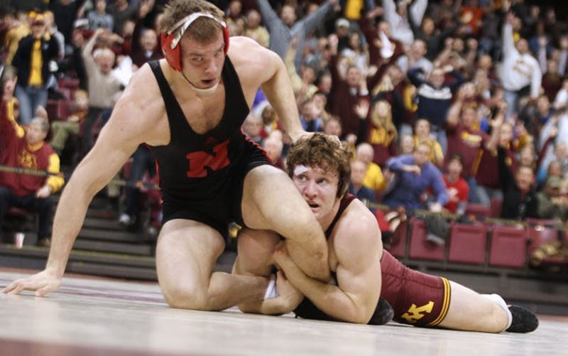 Minnesota's Kevin Steinhaus (184) records a late third-period takedown of Nebraska's Josh Ihnen during Sunday's dual at the Sports Pavilion.