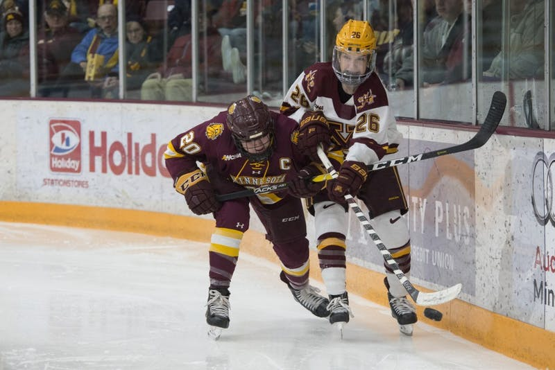 Forward Sarah Potomak fights for the puck at Ridder Arena on Saturday, Feb. 2. The Gophers lost to UMD in overtime 3-2.
