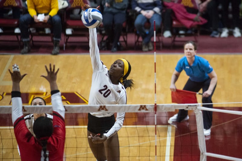 Outside hitter Adanna Rollins spikes the ball during the game against the Fairfield Stags in the first round of the NCAA tournament at the Maturi Pavilion on Friday, Dec. 6.