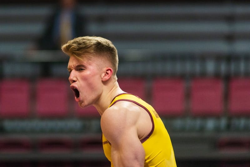 Gophers Junior Shane Wiskus celebrates after completing a routine on the still rings at Maturi Pavilion on Friday, Feb. 7. The Gophers went on to a 398-375.55 victory over the Washington Huskies.