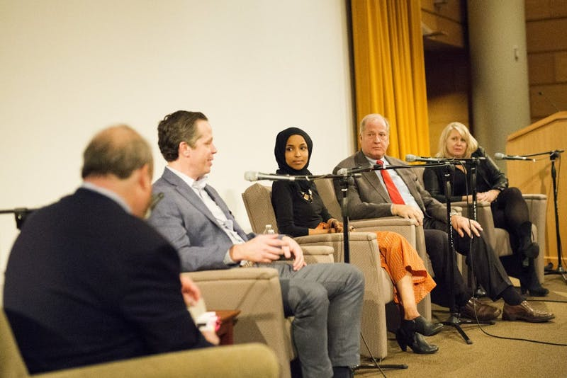 Ben Golnik, Ilhan Omar, Denise Cardinal and Vin Weber converse at the Post-Election Analysis event at the Humphrey School of Public Affairs on Wednesday, Nov. 6. The event took place the night after midterm elections to discuss what happened and the state of Minnesota.