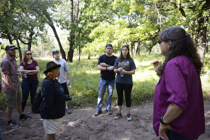 Jeannine Cavender-Bares discusses the effects of burning different land plots at the Cedar Creek Ecosystem Science Reserve in East Bethel on Saturday, Sept. 9. The center recently turned 75 years old and teaches scientists the current understanding of biodiversity and its importance.
