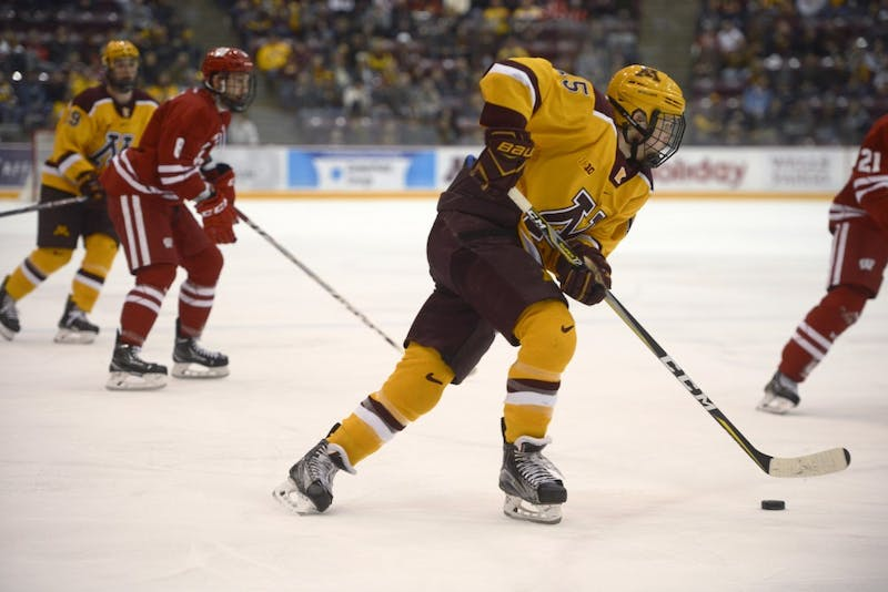 Sophomore forward Rem Pitlick skates with the puck on Saturday, Dec. 2 at 3M Arena at Mariucci.