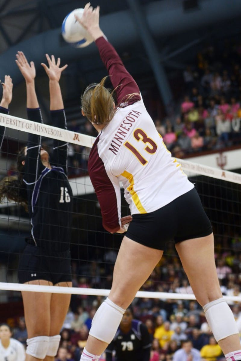 Minnesota outside hitter Ashley Wittman spikes the ball against Northwestern on Sunday at the Sports Pavilion.