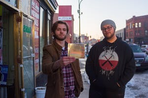 Musicians Alex Fuller and Jake Yaeger, members of the local band Hit the Skids, pose outside of Hard Times Cafe on Feb. 21. The band is set to release a new album entitled New Horizon and will play in the University's Battle of the Bands.