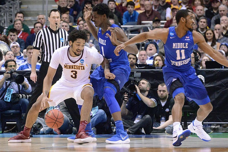 Sophomore forward Jordan Murphy looks to get around the Blue Raiders defense on Thursday, Mar. 16, 2017 in Milwaukee, Wisconsin at the Bradley Center. The Gophers played against Middle Tennessee Blue Raiders.
