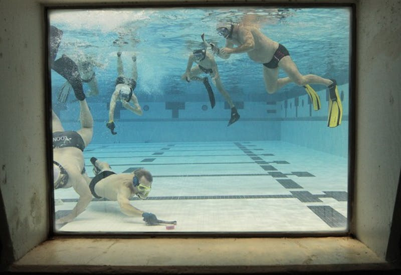 The Minnesota Underwater Hockey Club scrimmages at the University Aquatic Center on Sunday.