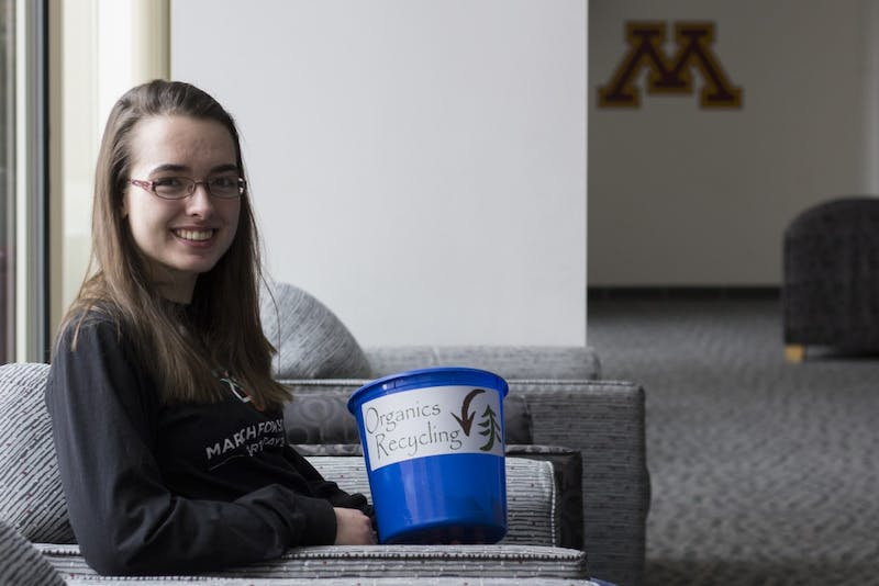 Environmental sciences, policy and management junior, Claudia Althoen, poses for portraits with an organics recycling bin at the Yudof Hall Club Room on Friday, Dec. 8. She started the organics recycling pilot program at Yudof Hall in collaboration with Dana Donatucci and Shane Stennes.