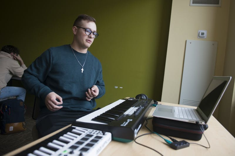 Noah Berghammer explains his music production setup in 17th Avenue Residence Hall on Wednesday, May 1. Berghammer sees music as a complimentary hobby to baseball, noting that one doesn't detract from the other.