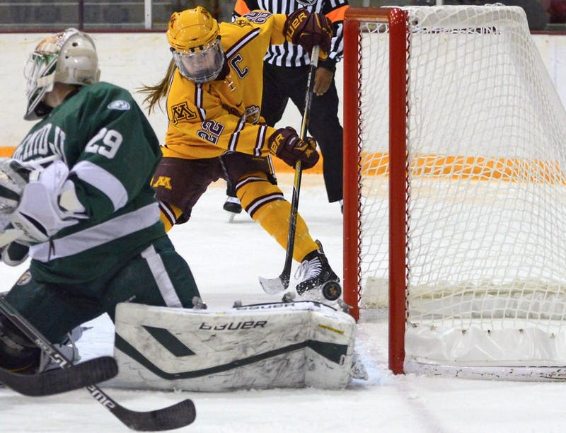 Forward Hannah Brandt scores a goal at Ridder Arena on Nov. 14, 2015, when the Gophers defeated Bemidji State 8-3.