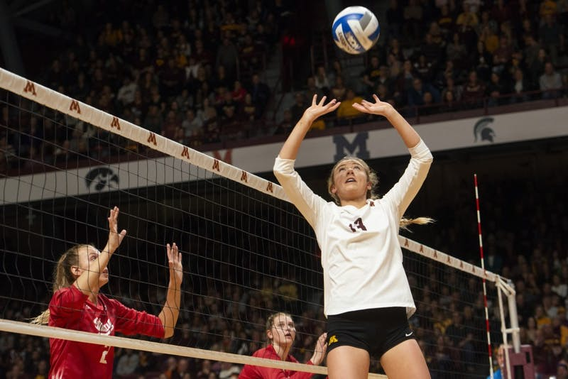 Samantha Seliger-Swenson sets the ball during the game against Indiana on Friday, Nov. 9 at Maturi Pavilion.