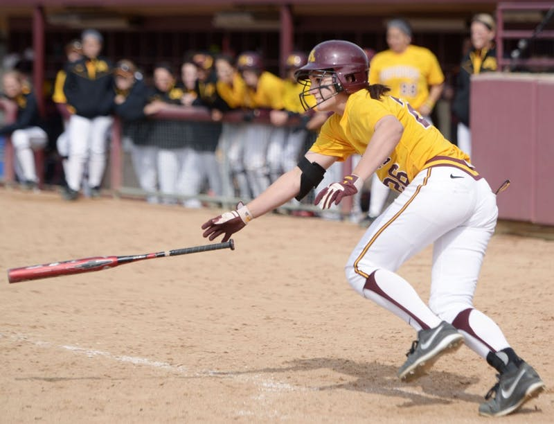 Minnesota's Kaitlyn Richardson throws her bat after a base hit against Wisconsin on Sunday, April 7, 2013, at Jane Sage Cowles Stadium.