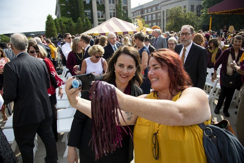 Attendees of the inauguration of Joan Gabel, the 17th President of the University of Minnesota, take selfies with her outside Northrop Memorial Auditorium on Friday, Sept 20, 2019.