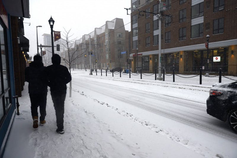 Pedestrians pass by Stadium Village Flats on March 5. Recently, the Minneapolis Police Department has responded to many incidents of non-resident juveniles entering campus apartments and using their amenities.