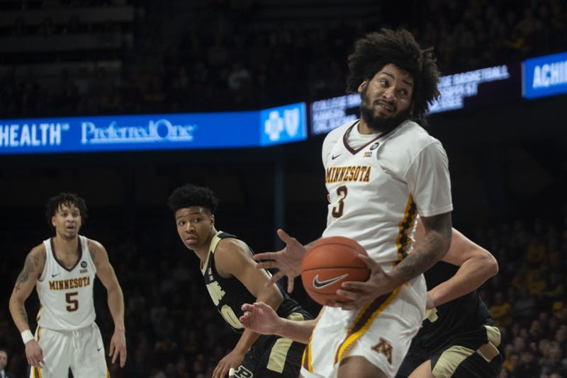Senior Jordan Murphy spins towards the basket on Tuesday, March 5 at Williams Arena.