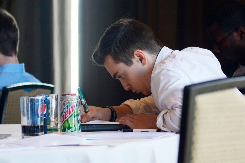 Senior Tyler Tracy takes notes during the Minnesota Cup semi-finalist workshop on Wednesday. Tracy's company, GoSolar! Kids, attempts to enlighten and teach kids about solar energy.
