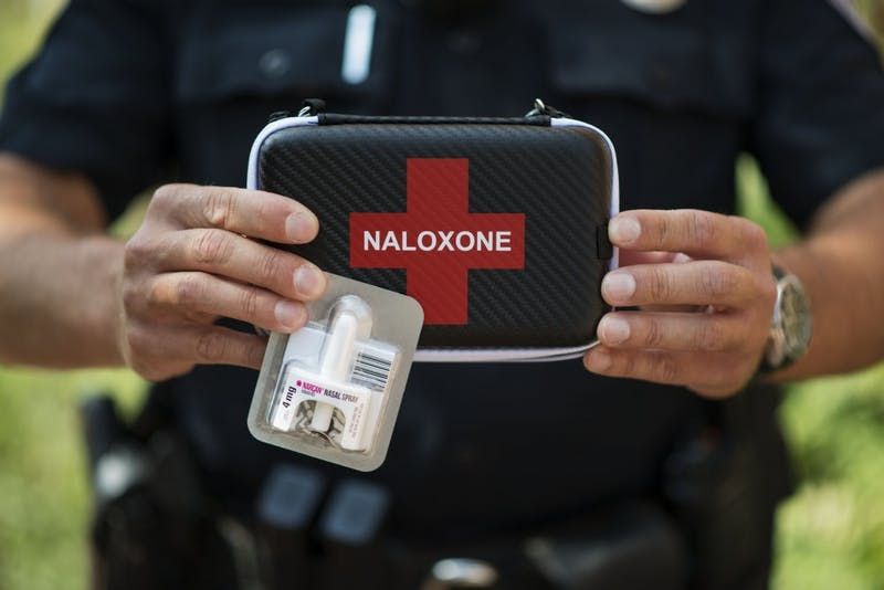 UMPD Officer Josh Betts holds a narcan nasal spray kit on Friday, Sept. 14, 2018 in Minneapolis. The kit can be used for emergency treatment of opioid overdose.
