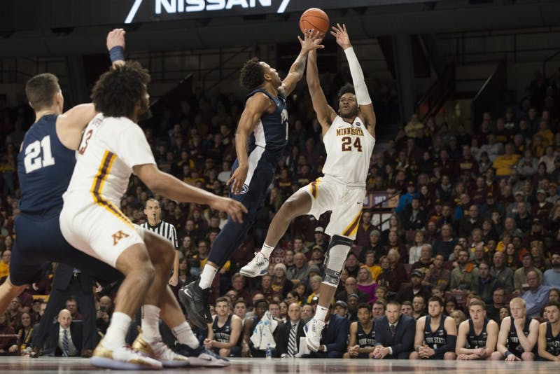 Forward Eric Curry shoots the ball at Williams Arena on Saturday, Jan. 19. The Gophers defeated Penn State 65-64.