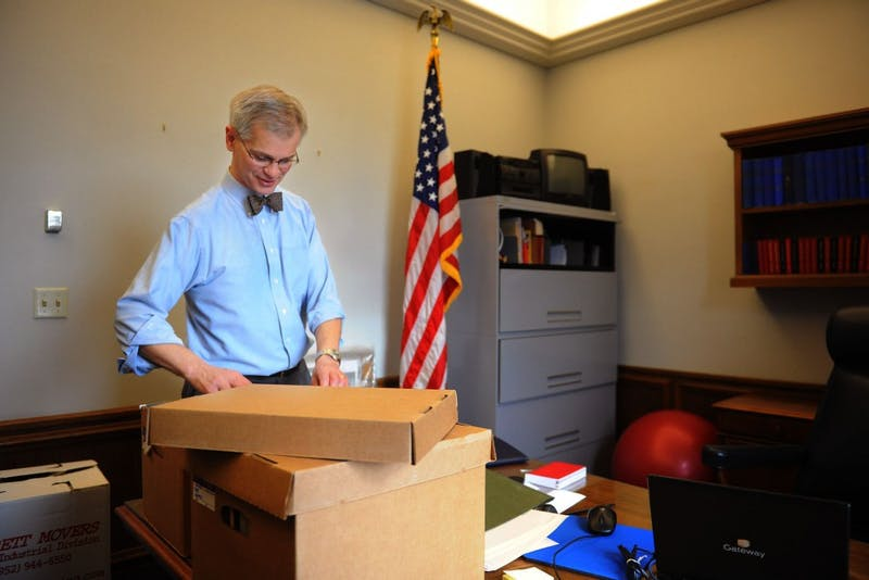 State Sen. John Marty goes through boxes of archives Tuesday after moving into his new office at the state Capitol in St. Paul.