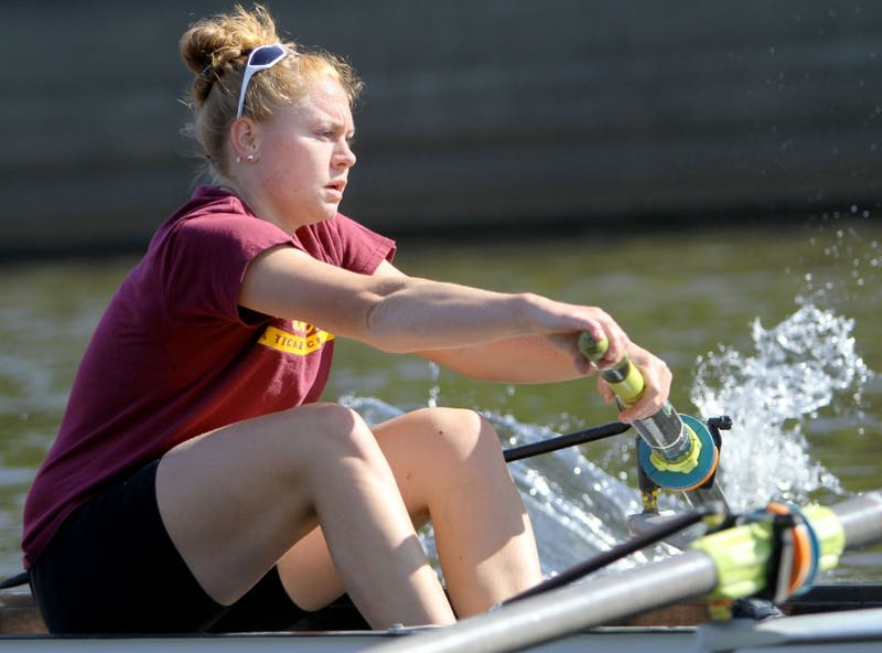 Ali Haws rows during practice Wednesday on the Mississippi River. Haws started as a member of the novice team and has worked her way up to the first varsity eight.