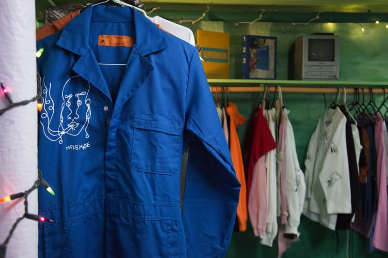 A MPLS MADE jumpsuit hangs on display in Elena Bagne's studio space in Northeast Minneapolis on Wednesday, Nov. 20. MPLS MADE is a custom hand-drawn and printed streetwear brand that uses thrifted clothing in an effort to be a sustainable.