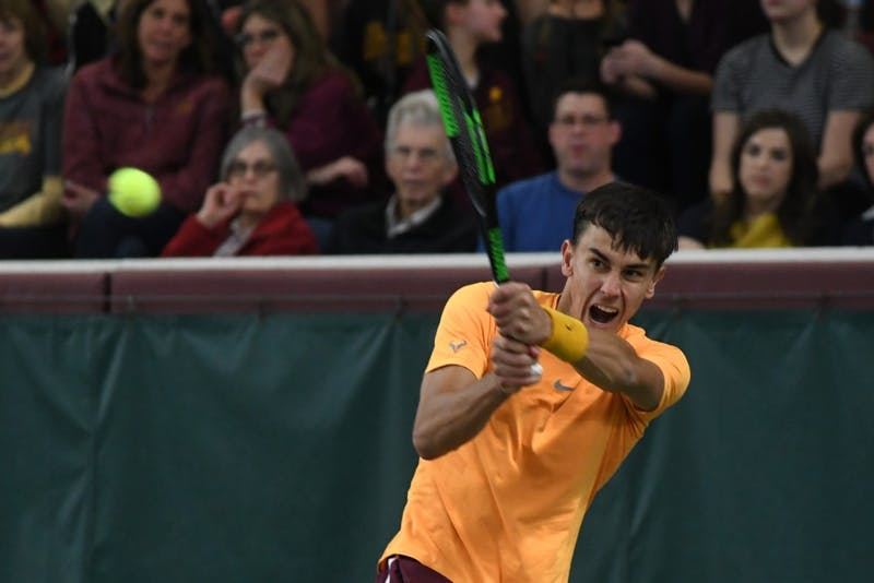 Sophomore Jackson Allen returns the ball on Friday, March 22 at the Baseline Tennis Center.