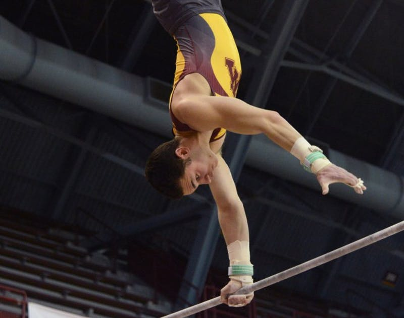 Senior Tristan Duran competes on the high bar during a meet on March 25, 2017 at Maturi Pavilion.
