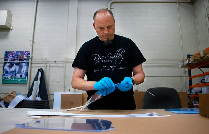 Jeff Kern, the large format manager at Bolger, assembles acrylic face shields at Bolger's facility in St. Paul on Friday, May 1.