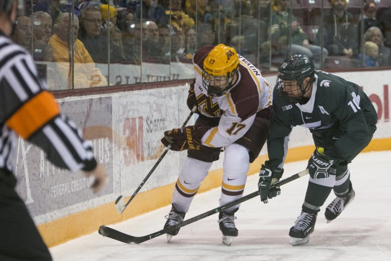 Forward Tommy Novak goes after the puck during the Gophers' game against Michigan State at 3M Arena at Mariucci on Friday, Nov. 3.