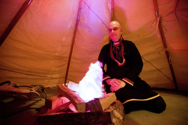 "Lavvu Coffee House owner Chris Pesklo sits in a Scandinavian Sami lavvu tent at the Swedish Institute on Friday, Jan. 25, 2013, in Minneapolis. Plesko said visitors to the new coffee house will be able to ""enjoy a latte in a lavvu."""