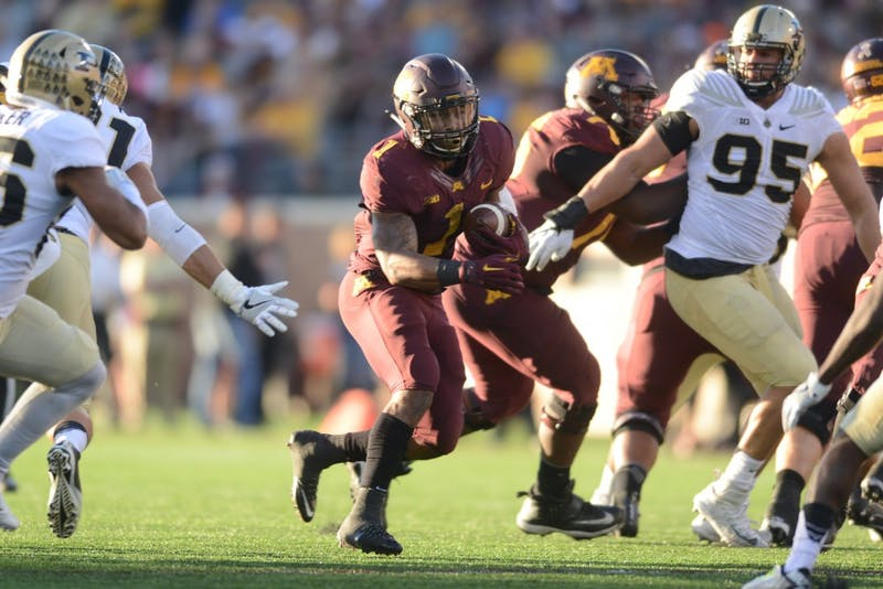 Gophers running back Rodney Smith handles the ball during the Gophers' game against Purdue at TCF Bank Stadium on Nov. 5, 2016, where the Gophers won 44-31.