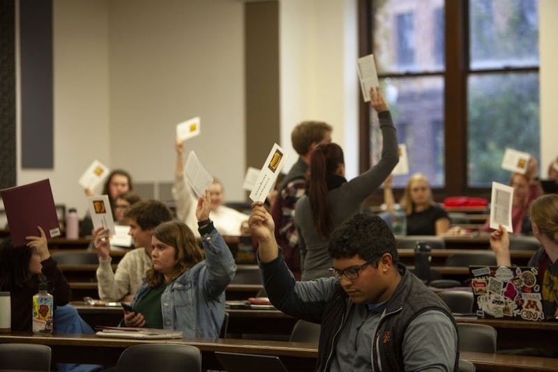 Student senators and representatives vote to move the forum to a closed session in Fraser Hall on Tuesday, Oct. 22. The vote passed, leaving only voting members and press for the remainder of the session.