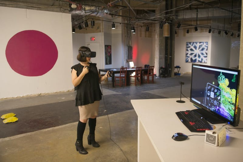 """Paige Dansinger, the founding director of Better World Museum in downtown Minneapolis, draws on """"Tilt Brush,"""" a program on the Oculus Rift in the virtual reality studio on Tuesday, Sept. 11. The Better World Museum is open to the public, where viewers can use the virtual reality studio, a collaborative space that Dansinger says people from all over the world have used."""