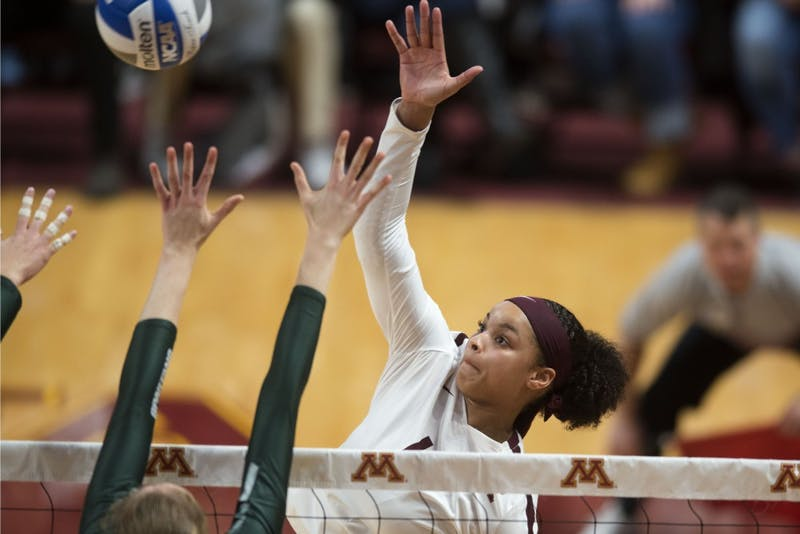 Junior Alexis Hart hits the ball at Maturi Pavillon on Saturday, Nov. 3. The Gophers won 3-2 against Michigan State and Hart scored her thousandth kill.