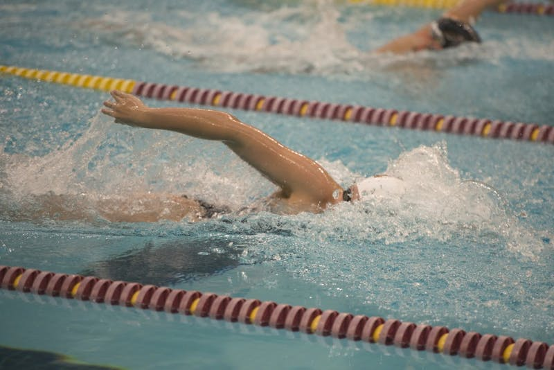 Freshman Mackenzie Padington competes in the women's 500 yard freestyle at the Jean K. Freeman Aquatics Center on Saturday, Jan. 27.
