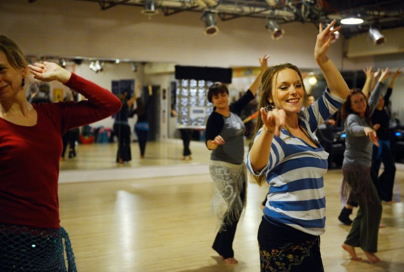 Jenna Neher, right, practices her Middle Eastern dancing skills at a belly dancing class taught by Cassandra Shore at the Jawaahir studio on Tuesday night.
