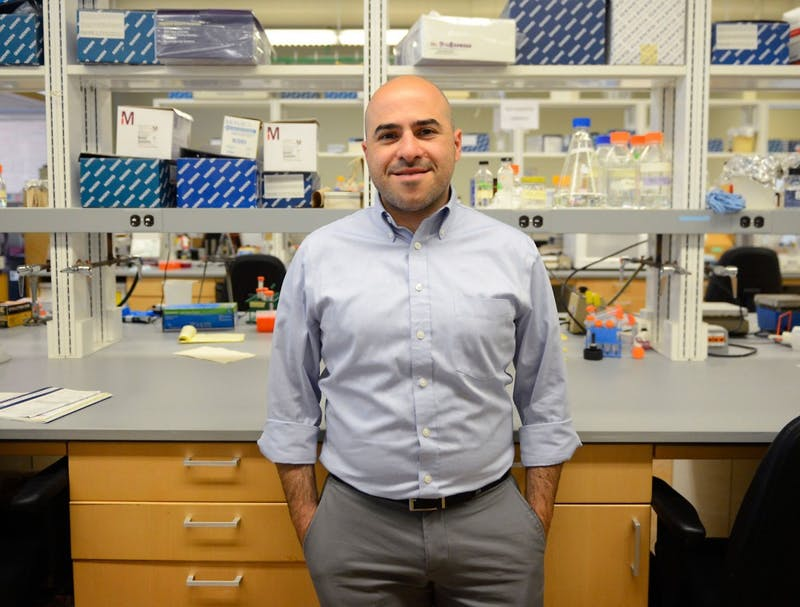 Ran Blekhman poses in the Blekhman Lab on Friday. Blekhman, who studies genetic variations and the microbiome with fellow researchers in the lab, co-authored a study last month linking the gut microbiome and colon cancer.
