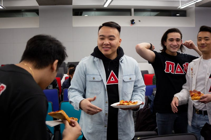Members of the campus student greek life council meet in Bruininks Hall to discuss changes, plans for the future, and to welcome new members over pizza and music on Friday, Jan. 24, 2020.