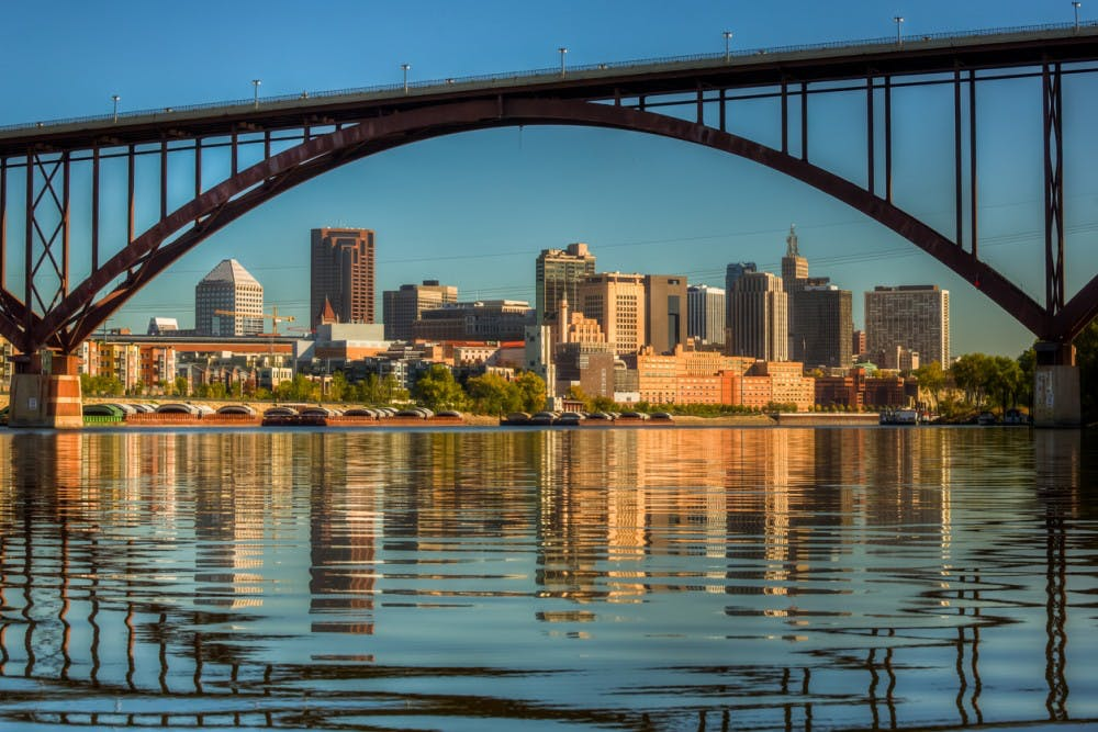 A view of downtown St. Paul in the morning with still water from the Mississippi River with reflection from the High Bridge.