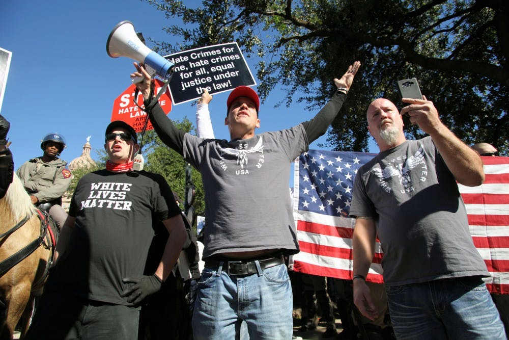 Austin, Texas, USA - November 19, 2016: A group of 'White Lives Matter' demonstrators protest just south of the Capitol grounds. The 'White Lives Matter' demonstrators, numbering about 20 people at the most, came from Houston with the message that the hate crime law is unfair to white people.