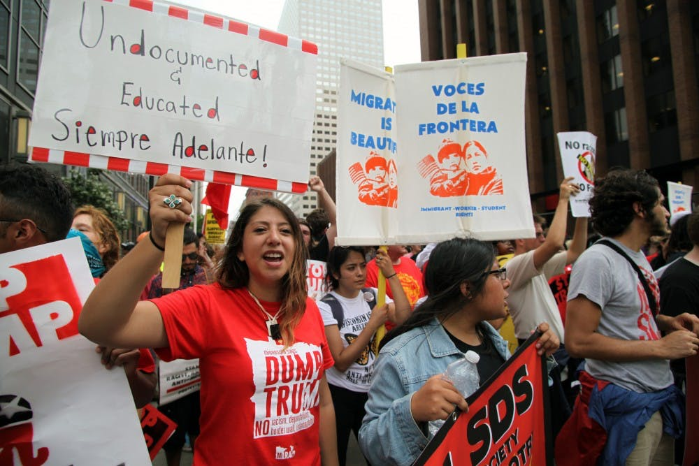 "Cleveland, Ohio, USA - July 18, 2016:  Young Hispanics support the Dream Act at the ""Stop Trump"" march on the first day of the Republican National Convention.  DACA (the Deferred Action for Childhood Arrivals) program defers immigration enforcement action against young people brought to the U.S. illegally as children."