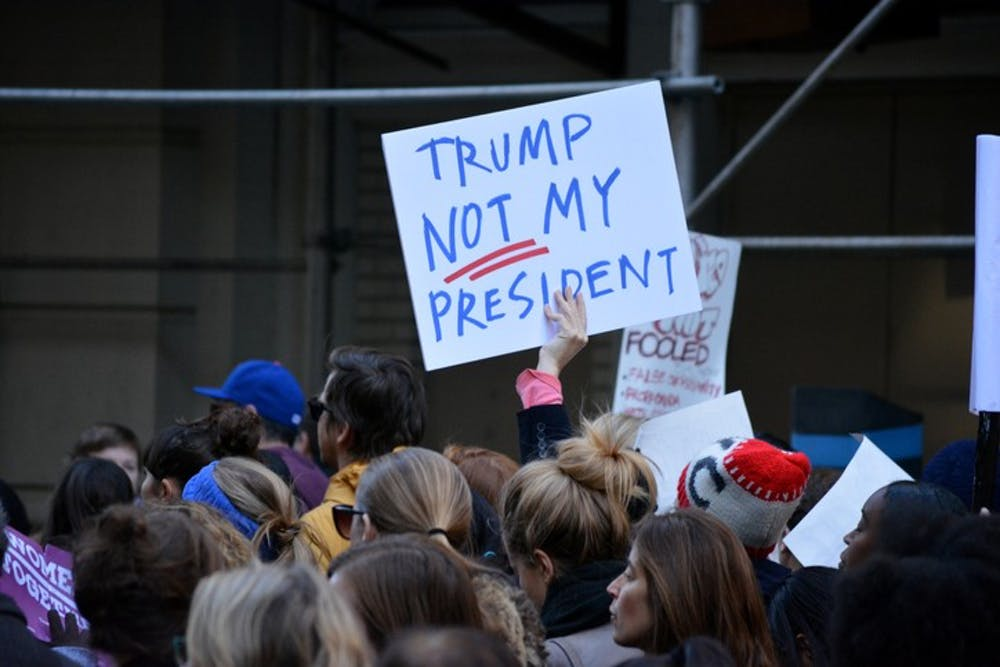 "New York, New York - November 12, 2016: Protester carrying a sign while marching in a ""Trump is not my President"" rally in response to the 2016 Presidential Election of Donald Trump in New York City in 2016."