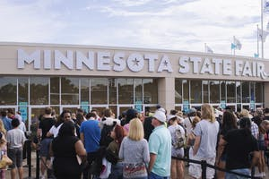 Minneapolis, United States - September 3, 2016: Crowd of people gathering around ticket booth at the last weekend of the Minnesota State Fair.