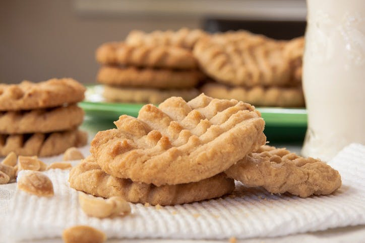 Fresh baked, homemade peanut butter cookies and milk.